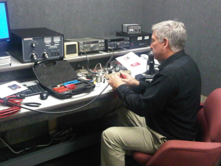 Bill Sloan, KC9ANG, TALARC Secretary and Assistant Director of the Internal Affairs Division at National Headquarters, preps antenna cables for soldering PL-259 connectors to the lines