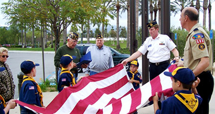 Boy Scouts fold the U.S. Flag