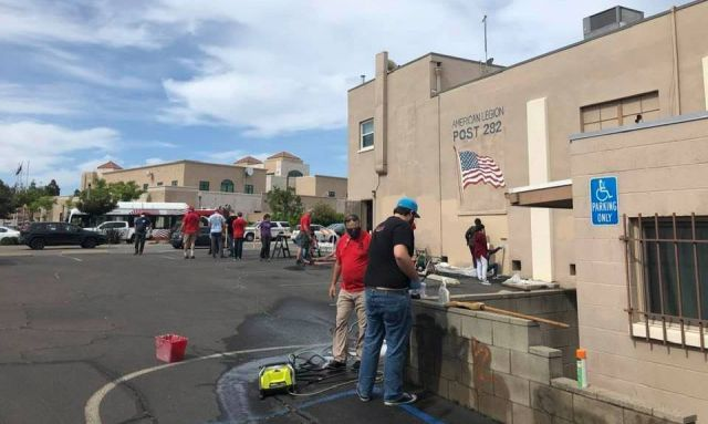 Community helps post clean up from vandalism