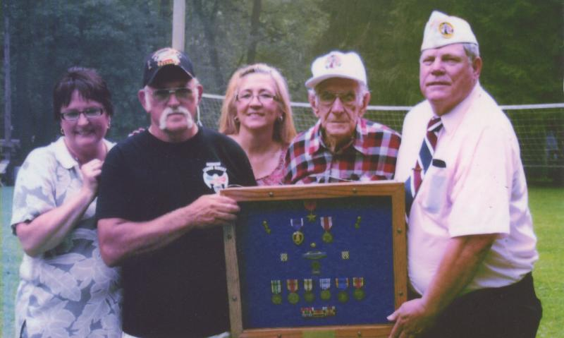 World War II vet receives medals earned in combat on 90th birthday
