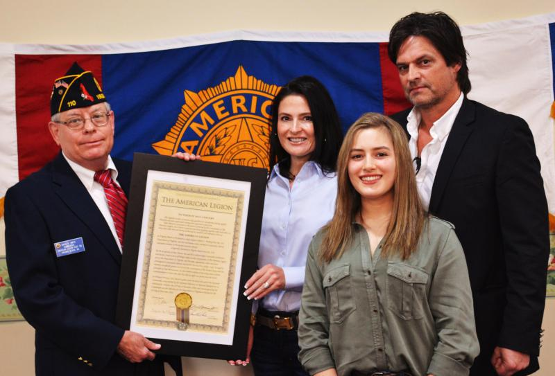 Post 110 presents copy of new post charter to Melberg family