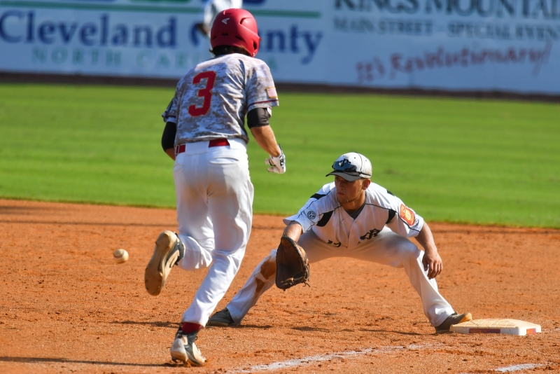 Spencer Lanier of Asheboro, N.C., Randolph County Post 45 beats Tyler  David of Midland, Mich., Berryhill Post 165 to first base for the out in game three of the 2018 American Legion World Series at Veterans Field at Keeter Stadium in Shelby, N.C., on Thursday, Aug. 16, 2018. Photo by Lucas Carter/The American Legion.