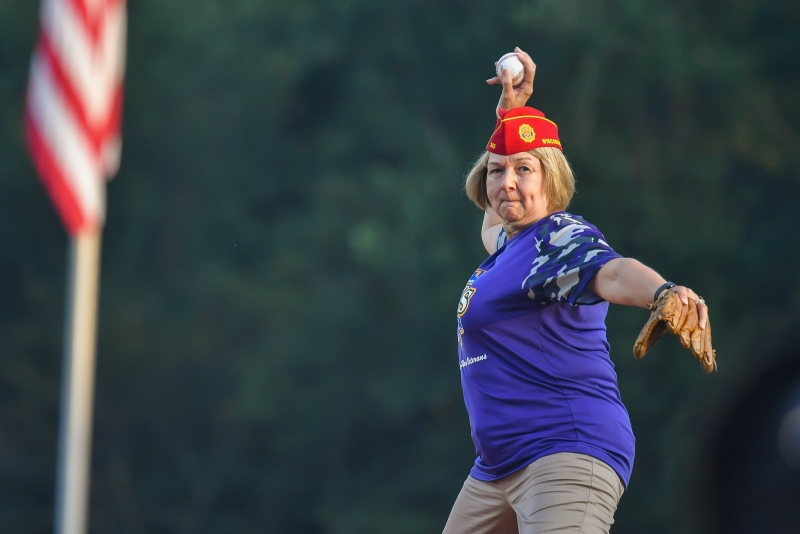 American Legion National Commander Denise H. Rohan throws out the first pitch before game four of the 2018 American Legion World Series saw Las Vegas, Nev., Post 40 overtake Meridian, Idaho, Post 113 10-0 after five innings at Veterans Field at Keeter Stadium in Shelby, N.C., on Thursday, Aug. 16, 2018. Photo by Lucas Carter/The American Legion.
