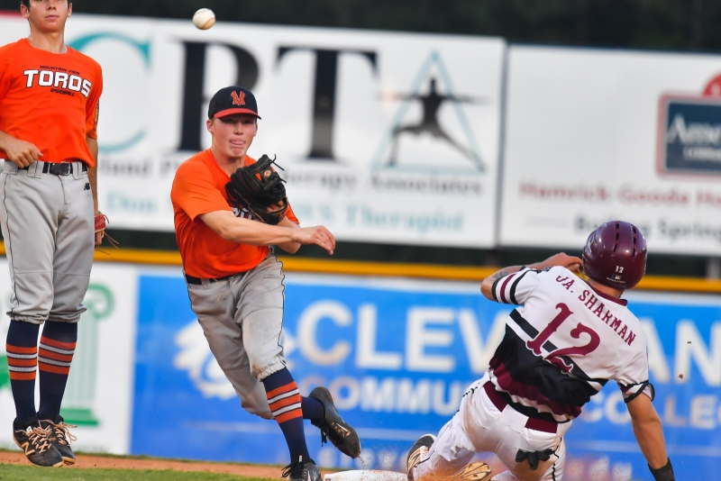 Carson Smith of Meridian, Idaho, Post 113 forces out Jason Sharman of Las Vegas, Nev., Post 40 at second and completes the double play in game four of the 2018 American Legion World Series at Veterans Field at Keeter Stadium in Shelby, N.C., on Thursday, Aug. 16, 2018. Photo by Lucas Carter/The American Legion.