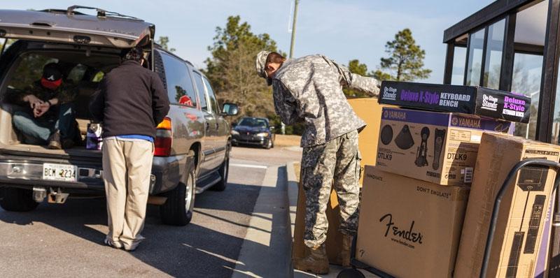 National Commander Koutz Delivers OCW Goods