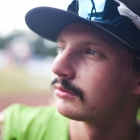 Beaux Bonvillain II of Bryant, Ark., Post 298 sports a mustache in the dugout for a portrait before Bryant, Ark., Post 298 goes on to defeat Hopewell, N.J., Post 339 7-4 in game 7 of The American Legion World Series on Saturday, August 12, 2017 in Shelby, N.C.. Photo by Lucas Carter/The American Legion.
