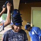 Shane Spencer stacks a rally-hat tower atop the head of teammate Trever Berg of Henderson, Nev., Post 40 during a 5-run 9th inning rally against Bryant, Ark., Post 298 during game 13 of The American Legion World Series on Monday, August 14, 2017 in Shelby, N.C.. Photo by Matt Roth/The American Legion.