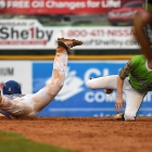 Roger Riley of Henderson, Nev., Post 40 slides safely into second as the ball is thrown wild of Seth Tucker of Bryant, Ark., Post 298 during game 13 of The American Legion World Series on Monday, August 14, 2017 in Shelby, N.C.. Photo by Matt Roth/The American Legion.
