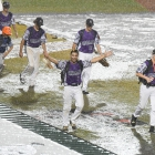 Members of the Shrewsbury, Mass., Post 397 team leave the stadium after their game against Omaha, Neb., Post 1 was postponed Saturday night, August 12, 2017 in Shelby, N.C.. Game 9 of The American Legion World Series will commence Sunday morning. Photo by Matt Roth/The American Legion.