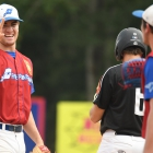 Evan Laney of Omaha, Neb., Post 1, left, interacts with Brooks Vosik between plays during game 14 of The American Legion World Series on Tuesday, August 15, 2017 at Veterans Field at Keeter Stadium in Shelby, N.C. Photo by Matt Roth/The American Legion.