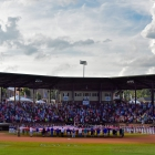 A garrison flag is unfurled during the national anthem before Henderson, Nev., Post 40 face off against Omaha, Neb., Post 1 for the championship game of The American Legion World Series on Tuesday, August 15, 2017 in Shelby, N.C.. Henderson, Nev., beat Omaha, Neb., 2-1 becoming the 2017 ALWS Champions.  Photo by Matt Roth/The American Legion.