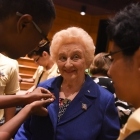 Jarred Walker pins a Maryland Boys State pin on the lapel of Holocaust survivor Nesse Godin after she spoke to the American Legion Boys Nation delegates on Thursday, July 27, 2017. Photo by Lucas Carter / The American Legion.