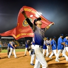 John Howard Bobo of Henderson, Nev., Post 40 carries their national championship banner after his team's 2-1 win over Henderson, Nev., Post 40 during the championship game of The American Legion World Series on Tuesday, August 15, 2017 in Shelby, N.C.. Photo by Matt Roth/The American Legion.