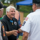 Medal of Honor recipient James C. McCloughan mingles with other members of Post 49 before a memorial dedication ceremony at The American Legion Edward W. Thompson Post 49 in South Haven, Mich.. Photo by Robert Franklin/The American Legion