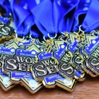 American Legion World Series Host City Welcome event medals sit on a table Wednesday, August 9, 2017 in uptown Shelby, N.C.. Photo by Matt Roth/The American Legion.
