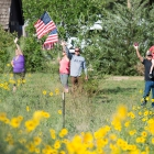 Supporters wave to the Legacy Run as they pass a KOA campground in Loma Linda, Colo. on Sunday, August 13, 2017. Photo by Clay Lomneth / The American Legion.