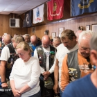 Members of the American Legion family bow their heads in prayer at Post 16 in Fallon, Nev. on Wednesday, August 16, 2017. Photo by Clay Lomneth / The American Legion.