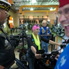 Tony James, from Indiana Post 200 and Pam Kreutzer from Kansas Post 180 joke around with American Legion National Commander Charles Schmidt in the Battle Born Harley Davidson in Carson City, Nevada on Thursday, August 17, 2017. Photo by Clay Lomneth / The American Legion.