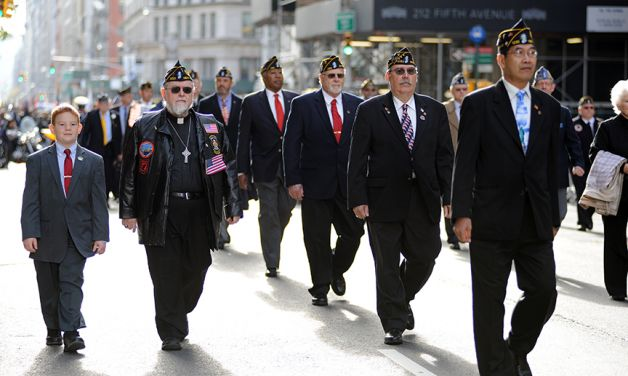 "Legionnaires march in ""America's Parade"""