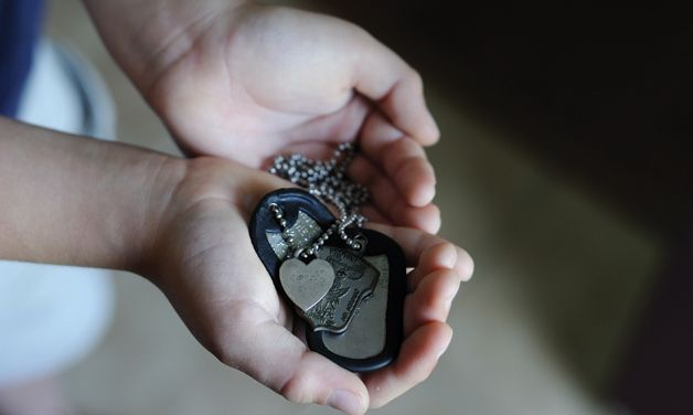 Jack Crider holds his father's dog tags. Included on the chain is a heart engraved