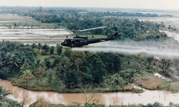 A Huey helicopter sprays the Agent Orange defoliant in Vietnam. U.S. Army photo