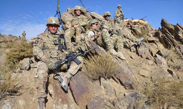 Capt. Michael Stewart, commander of Able Company, 3rd Battalion, 66th Armor Regiment, 172nd Infantry Brigade, takes a break with his men during Operation Iron Mountain Goat II out of Combat Outpost Bad Pakh in Afghanistan's Laghman province.