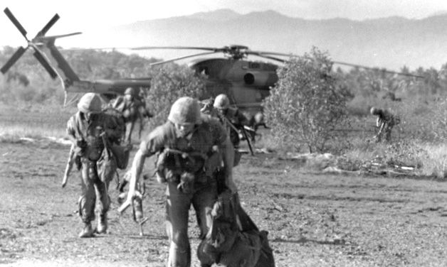 U.S. Marines scramble from  a CH-53 helicopter during the  SS Mayaguez operation.