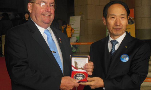 National Commander Koutz visits the Far East