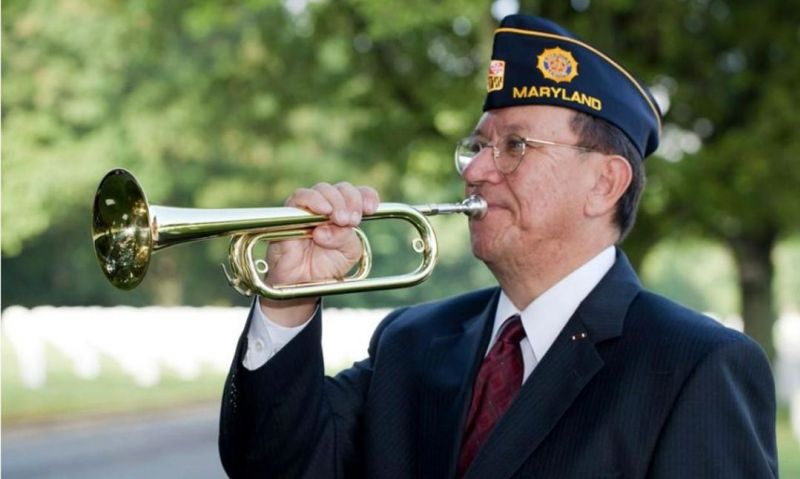 Legionnaire among thousands who play taps in a moment of remembrance
