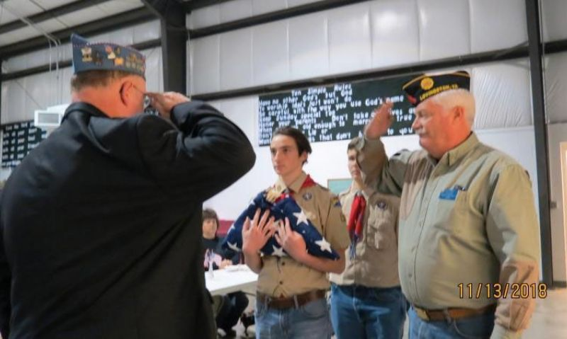 World War I veteran's burial flag refolded by Scouts