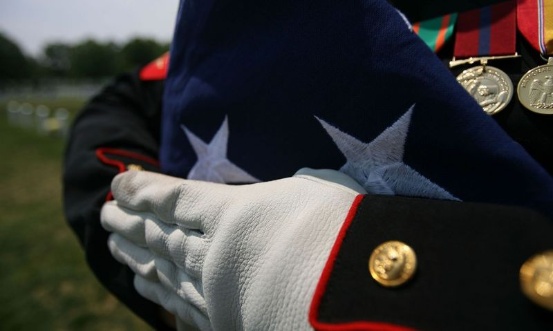 A folded flag 'carries the spirit and memories of our loved ones'