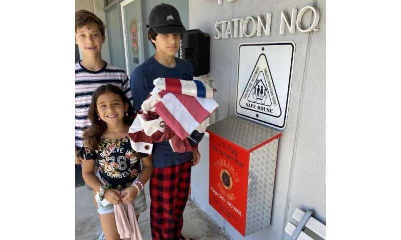 Young siblings collects flags to properly dispose
