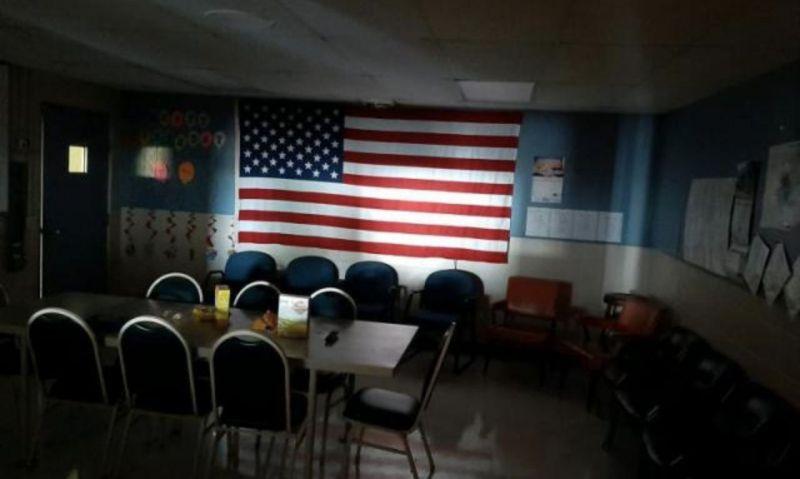 Flag illuminated in dark room
